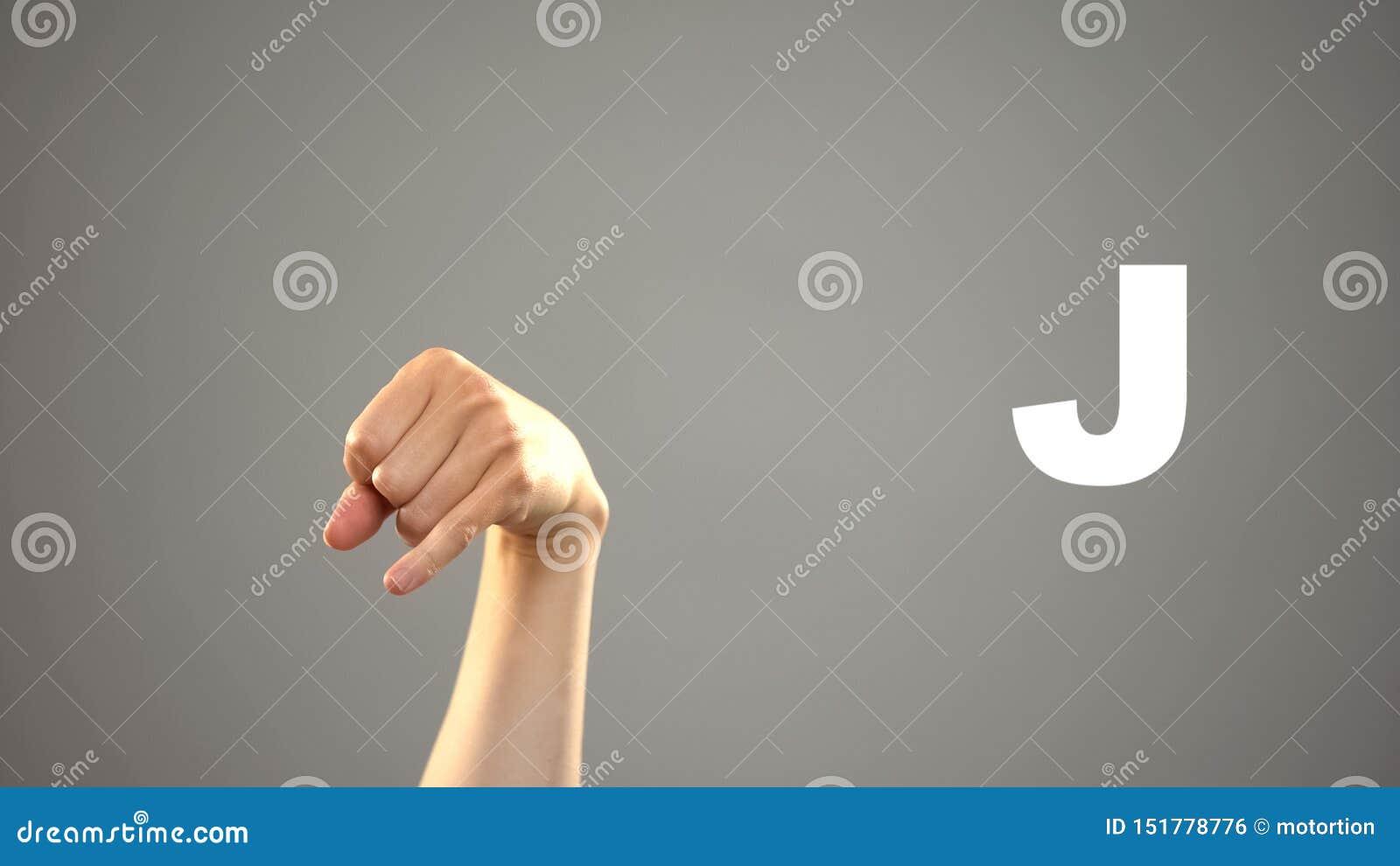 Brief J in gebarentaal, hand op achtergrond, mededeling voor doof, les