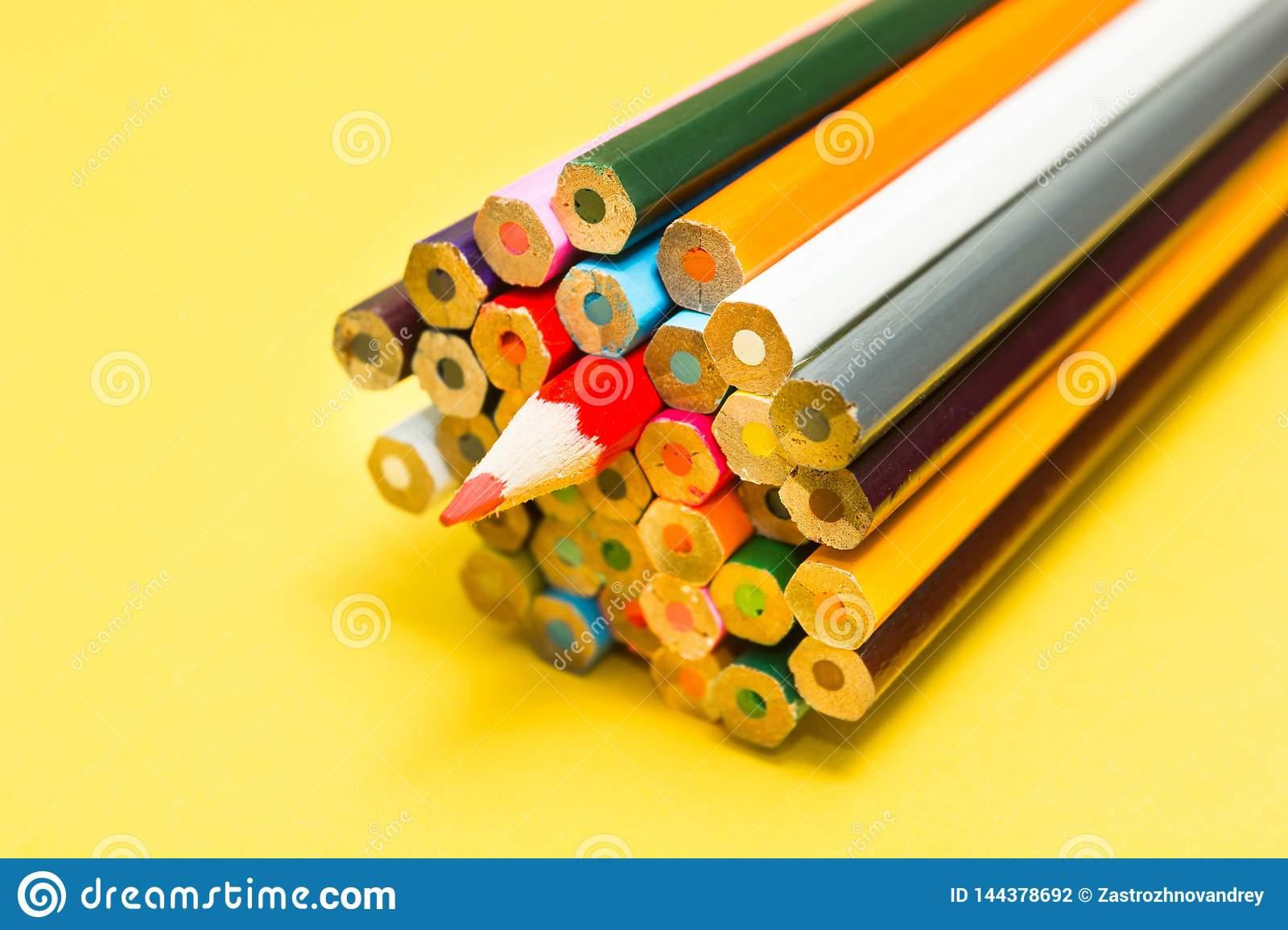 Bright abstract background of multi-colored pencils