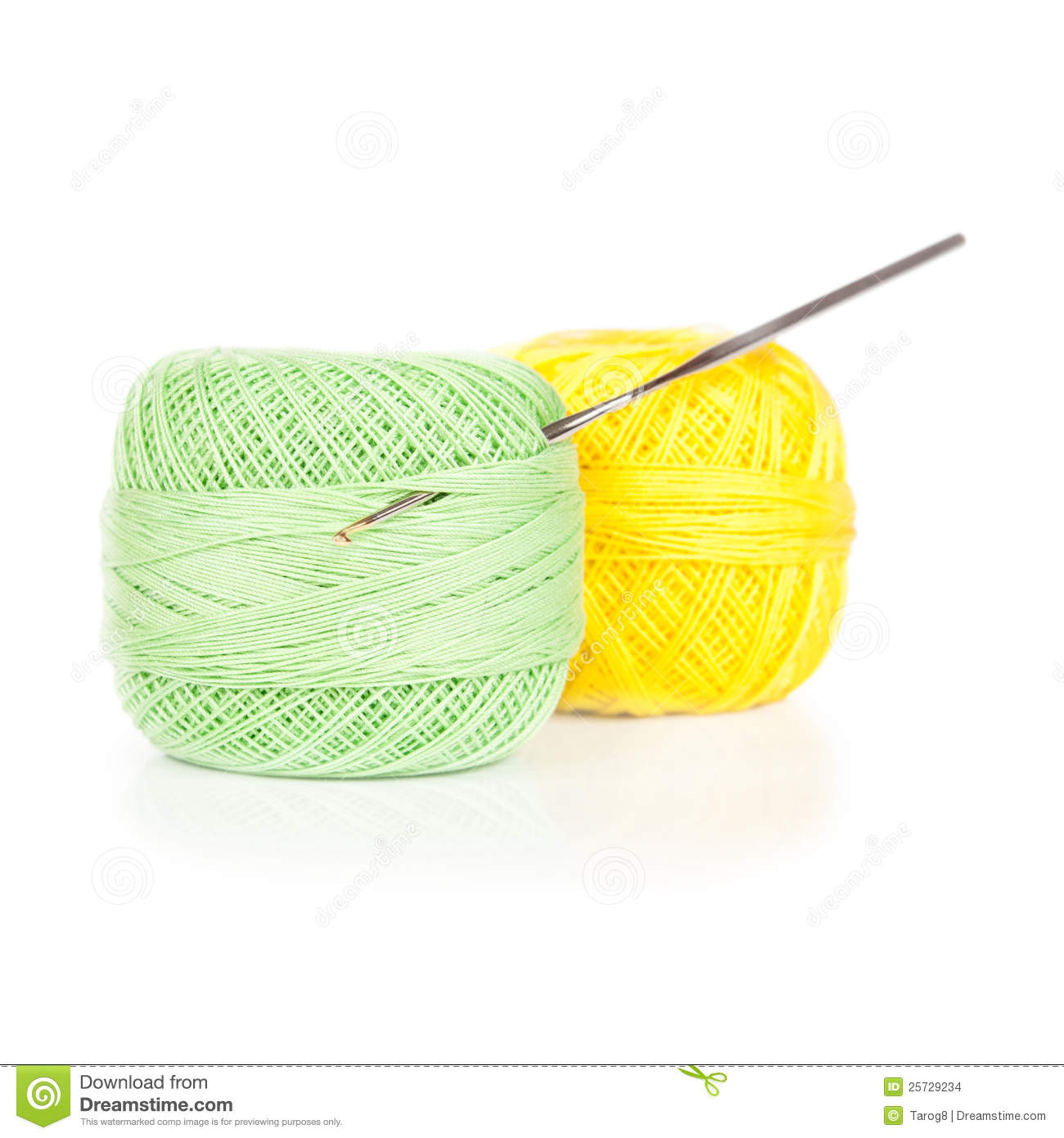 Bright balls of yarn with crochet isolated