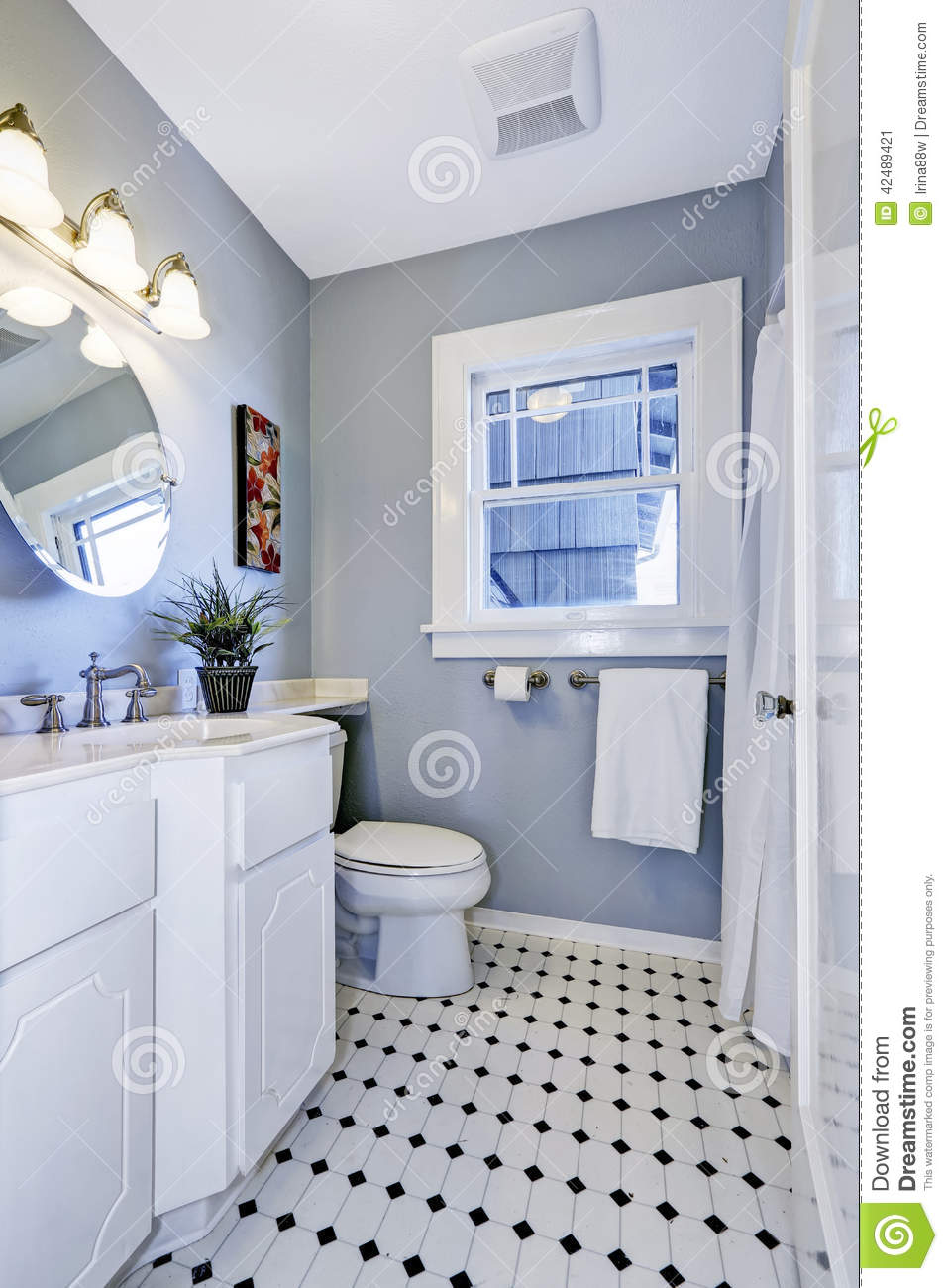 bright bathroom interior light blue color simple white cabinet toilet 42489421