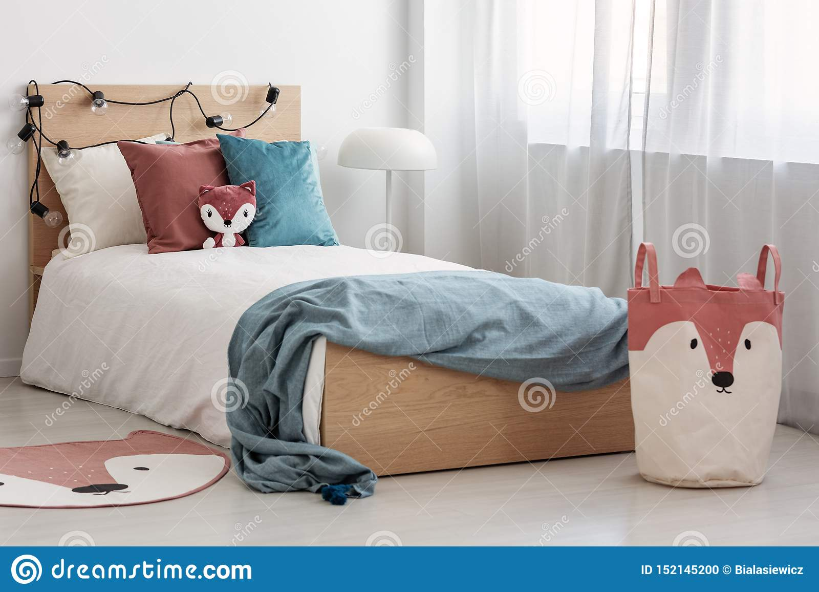 Bright Bedroom Interior With Single Bed With Turquoise Blanket On White Bedding And Colorful Pillows And Toy Stock Photo Image Of Chic Design 152145200