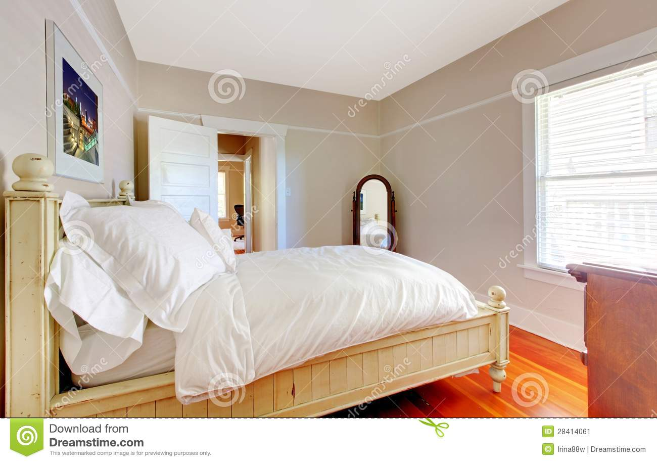 Bright Bedroom With White Bed And Beige Walls. Stock Image ...
