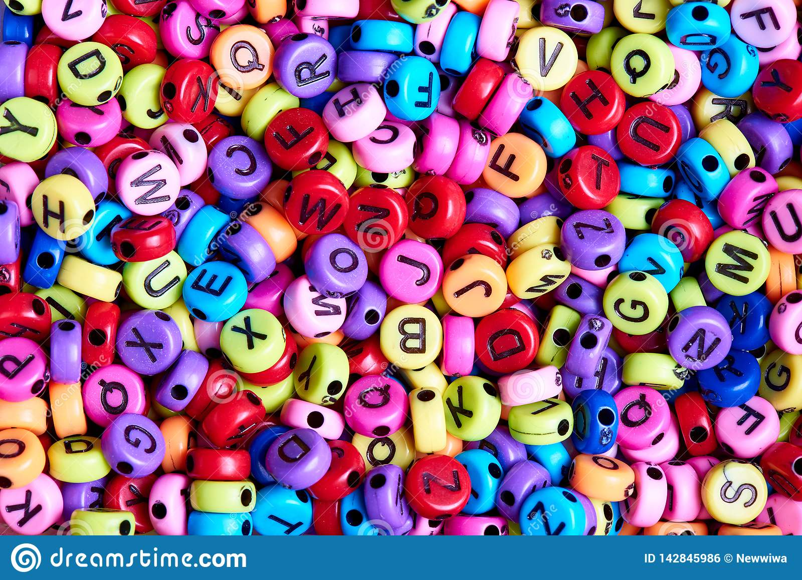 Bright colored beads with English letters close-up
