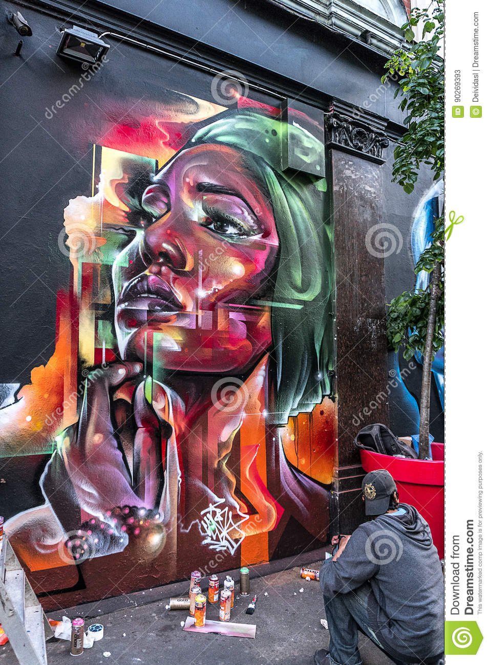 Bright colorful female face graffiti