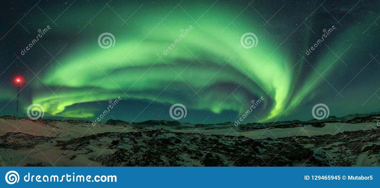 Bright colorful northern lights in the night sky.