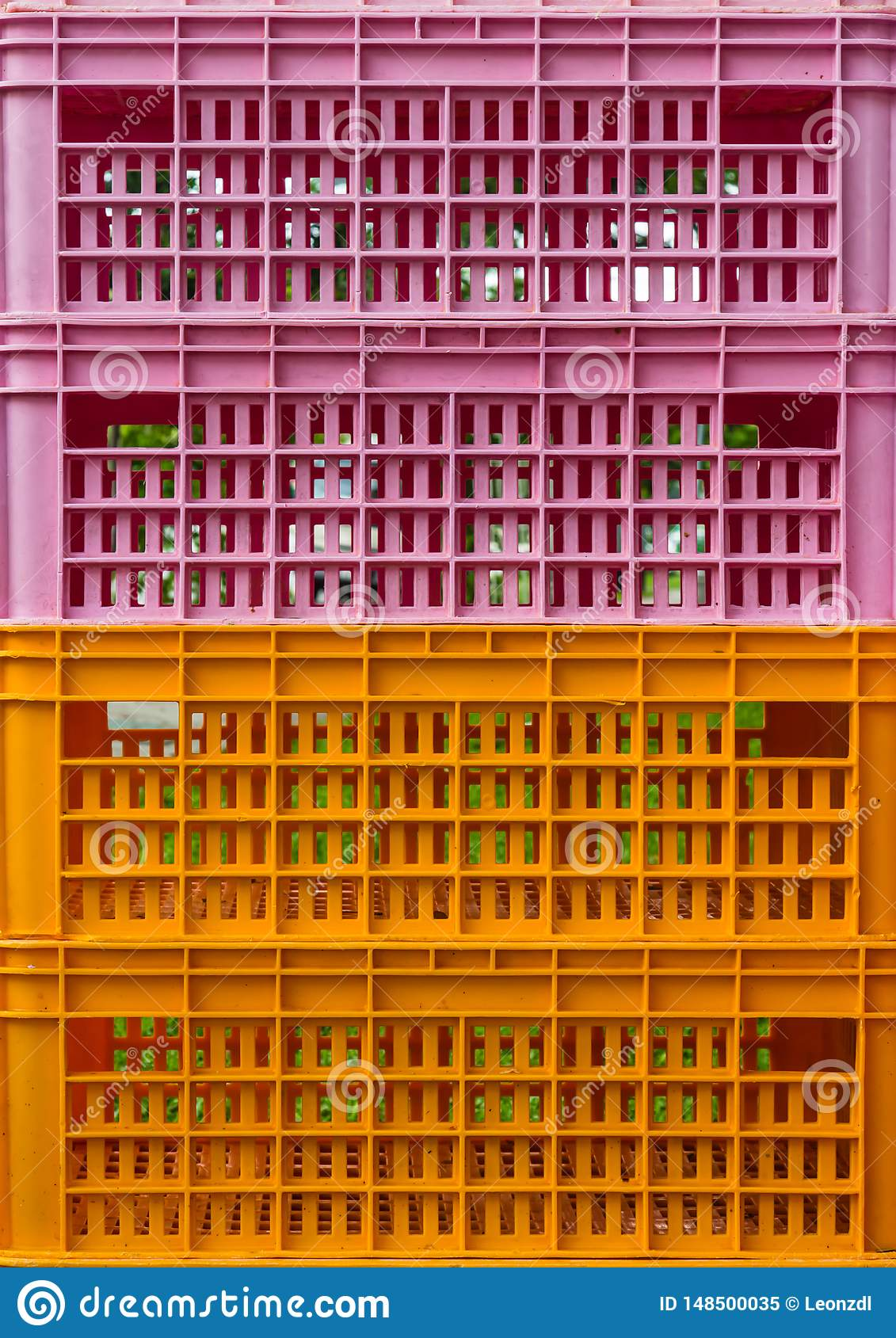 Bright colorful plastic boxes background view