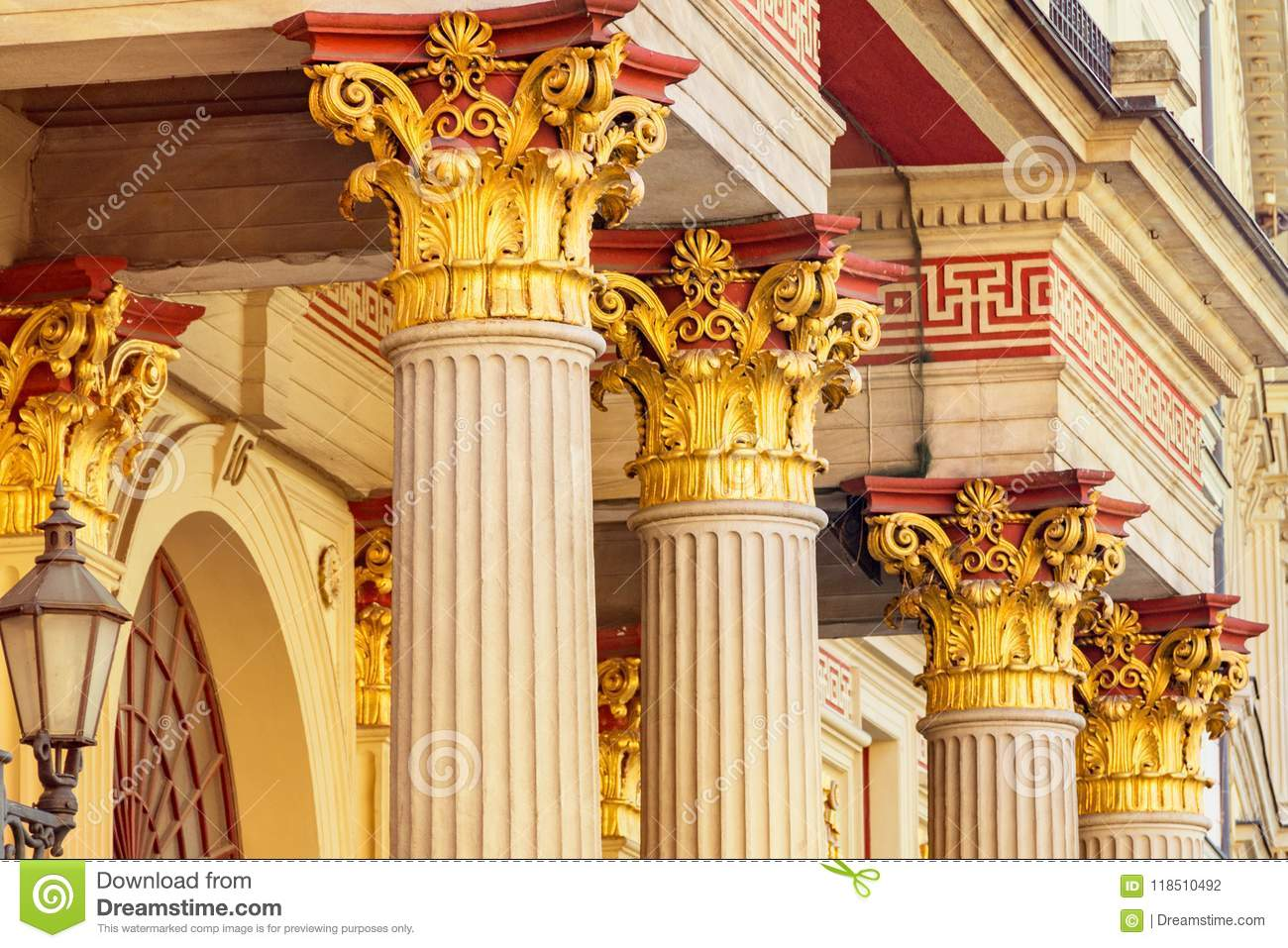 Bright columns of the building, Old courtyard, gilded cola