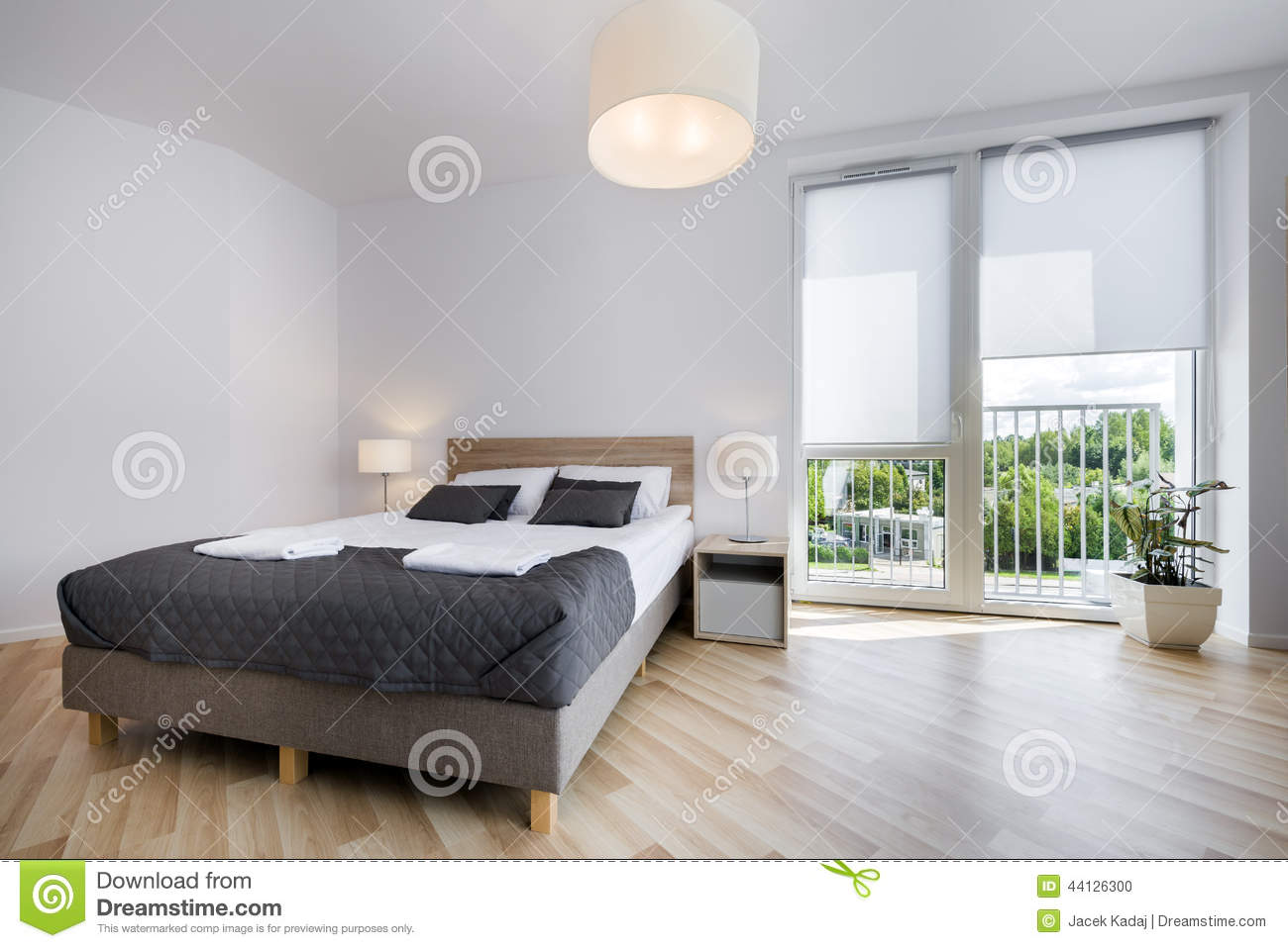 Bright and comfortable bedroom interior design stock photo - Luminaire chambre adulte ...