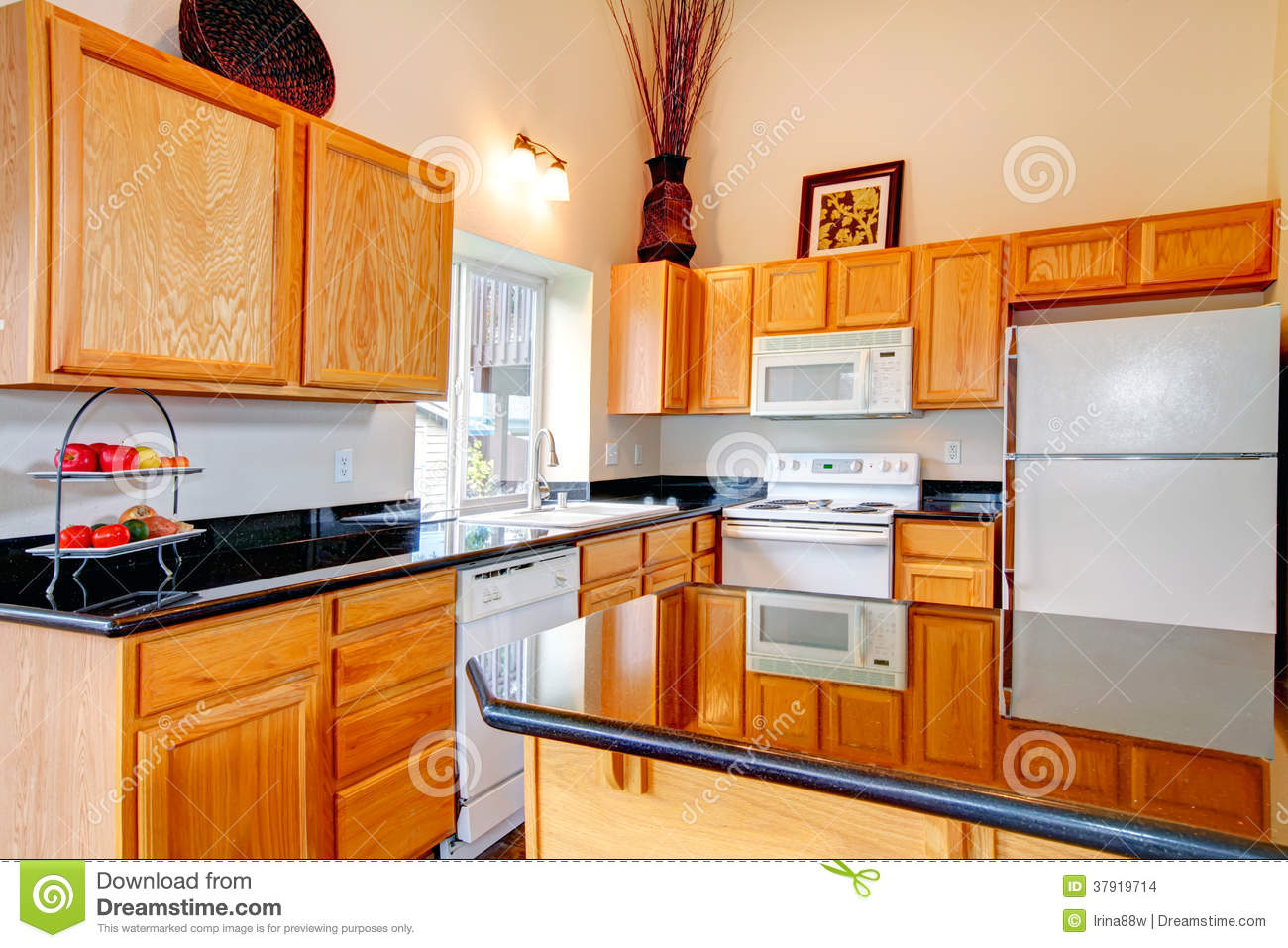 Bright cozy kitchen room stock images image 37919714 for Brown kitchen cabinets with black appliances