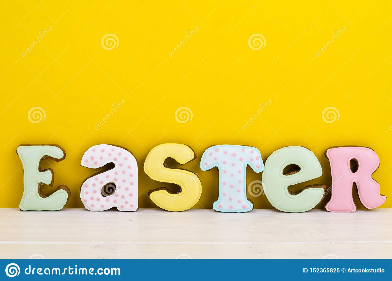 Bright Easter background. Decoration eggs and colorful letters forming words EASTER. Celebration concept.