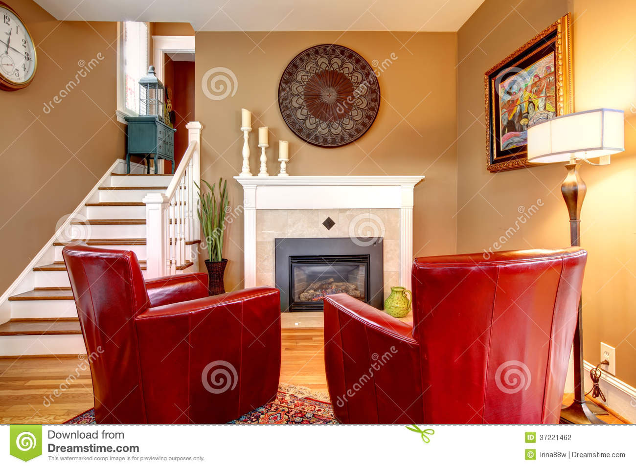 Bright family room with electric fireplace and elegant red chair. Bright Family Room With Electric Fireplace And Elegant Red Chair