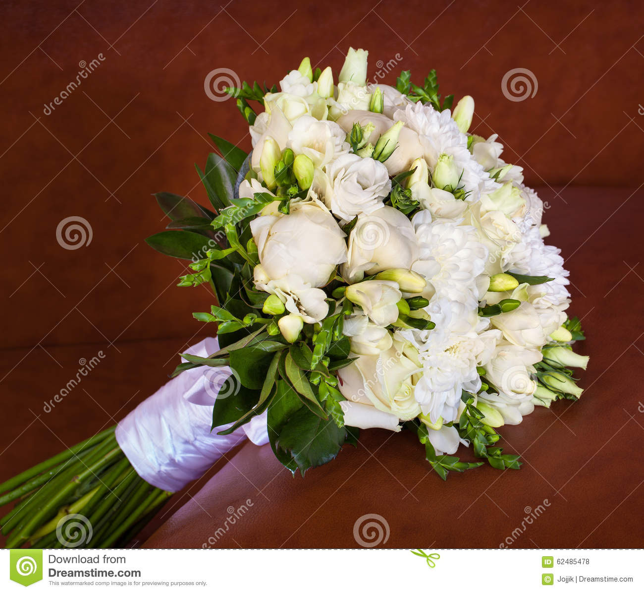 Bright Flower Wedding Bouquet On Brown Leather Sofa Stock Photo