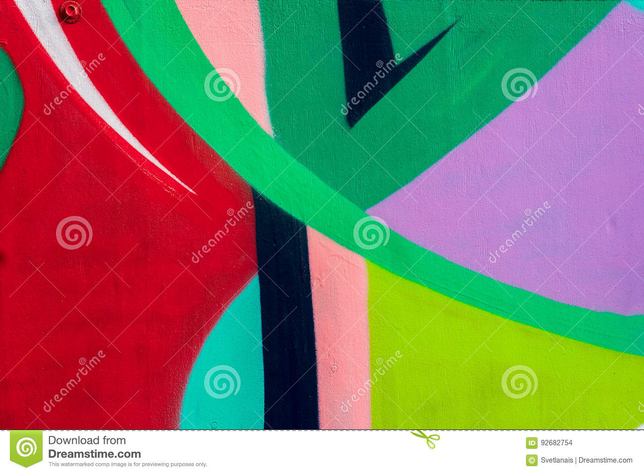 Bright fragment of wall with detail of graffiti, street art. Abstract creative drawing fashion colors. Modern iconic