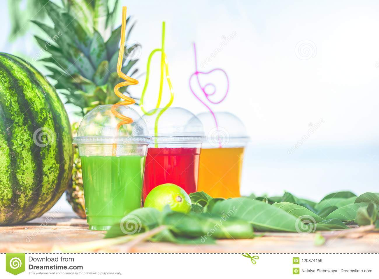 Bright Fresh healthy juices, fruit, pineapple, watermelon on the background of the sea. Summer, rest, healthy lifestyle