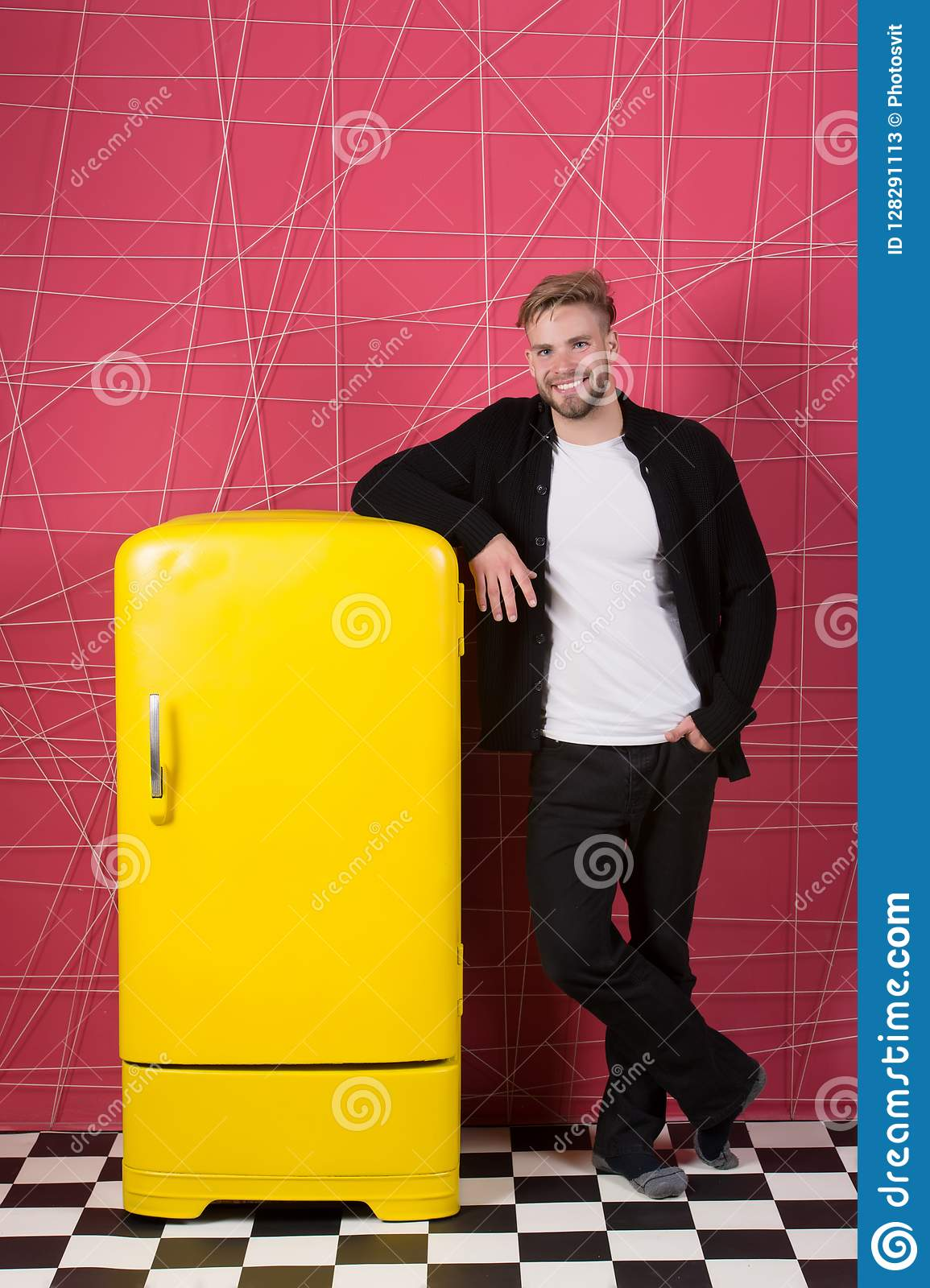 Bright fridge household appliances interior object. Designer adding accent to interior. Man lean retro vintage yellow