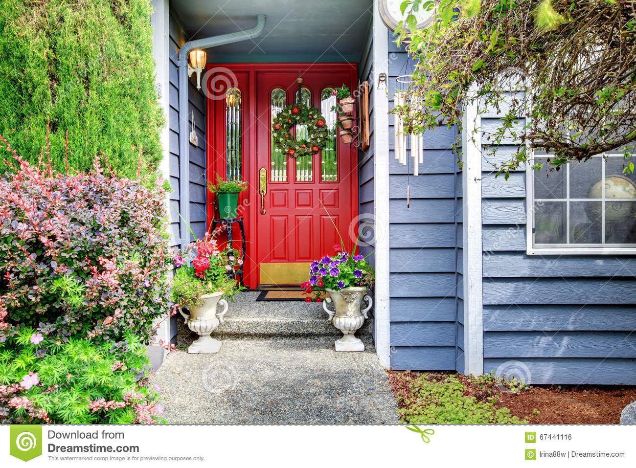 Bright Front Red Door To Blue American Home With Floral Exterior