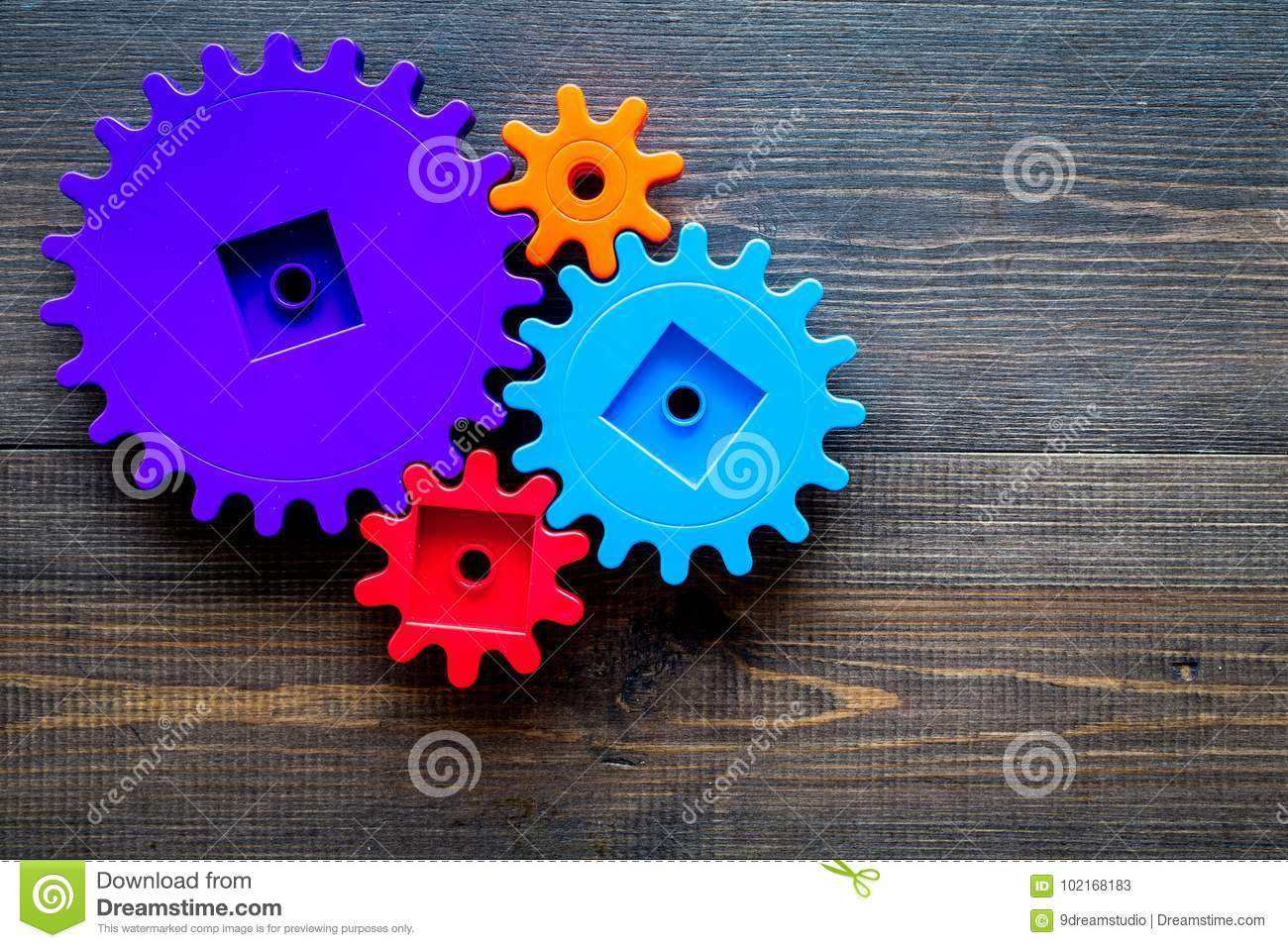 Bright gears for great technology of team work and correct mechanism on wooden background top view copyspace