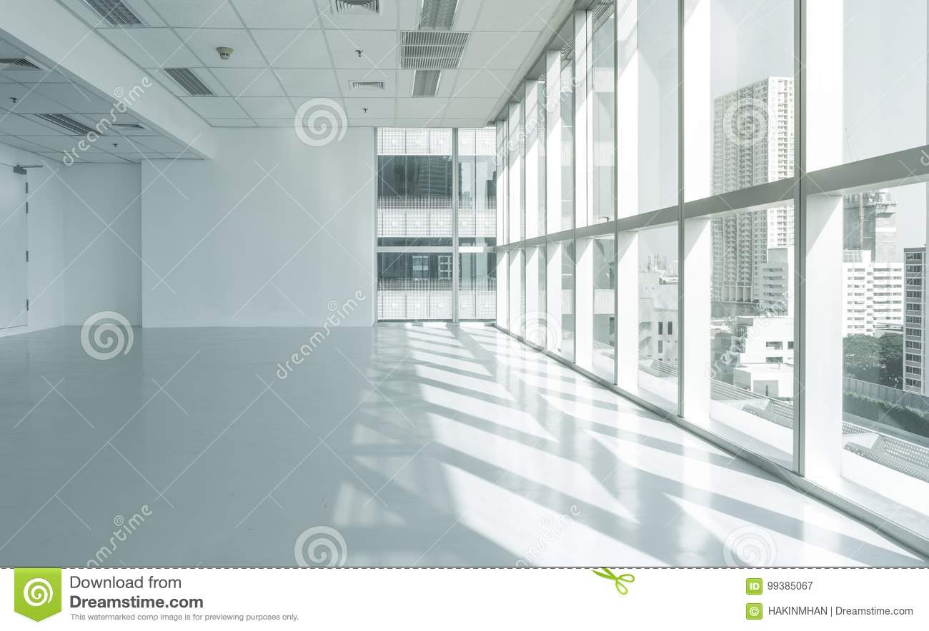 Bright glass wall office building with city view