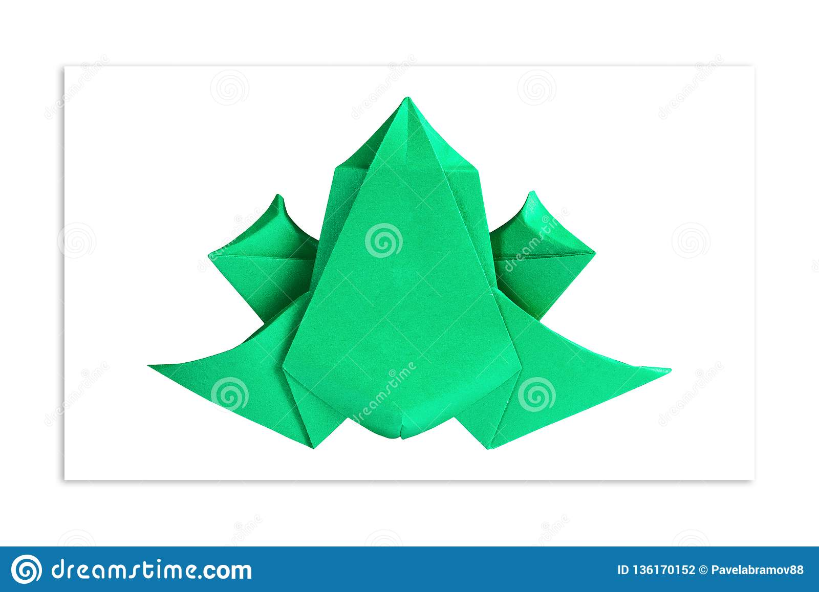 Origami. Bright green frog out of paper. The concept of minimalism
