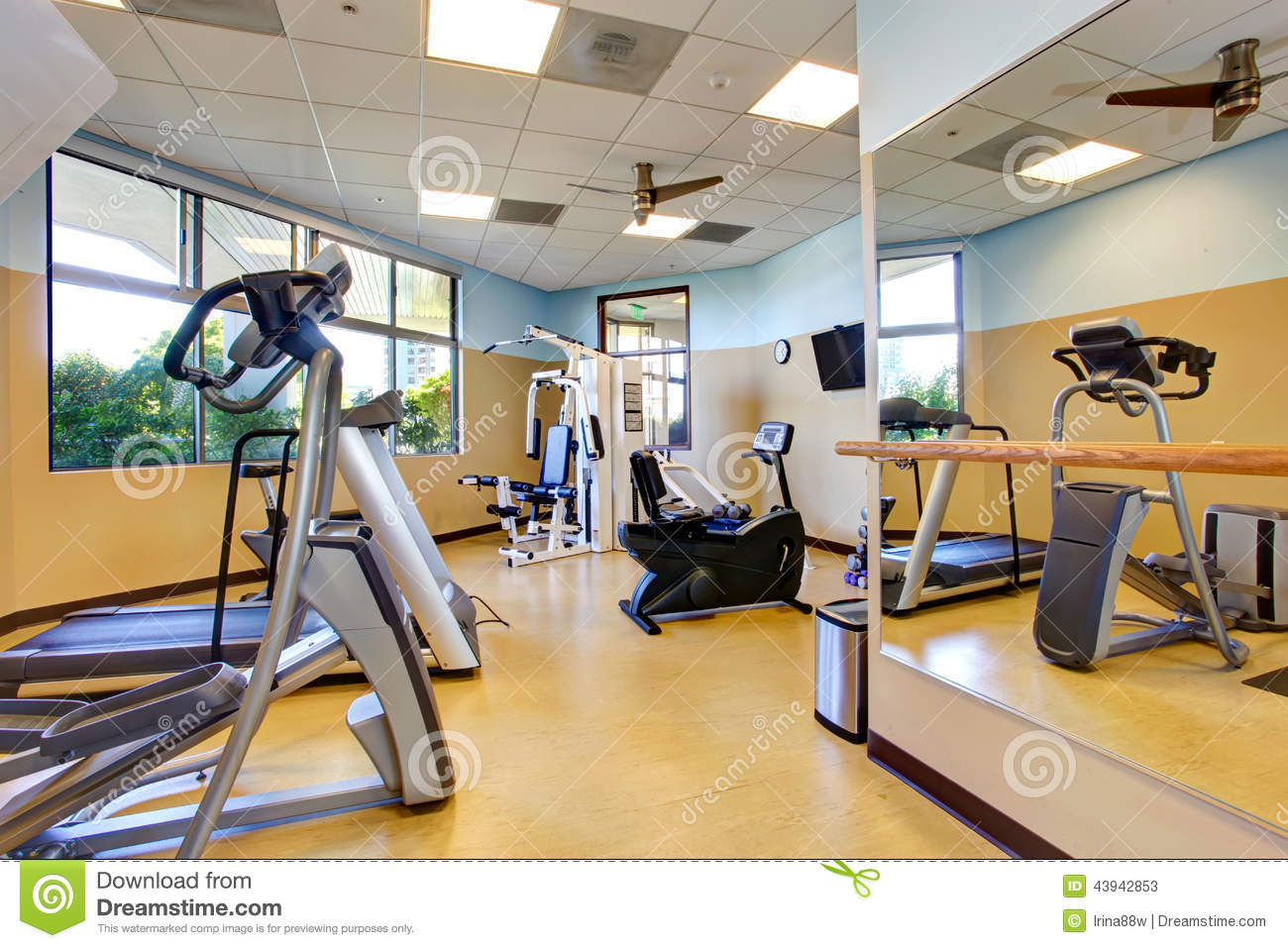 Bright gym room in residential building stock photo