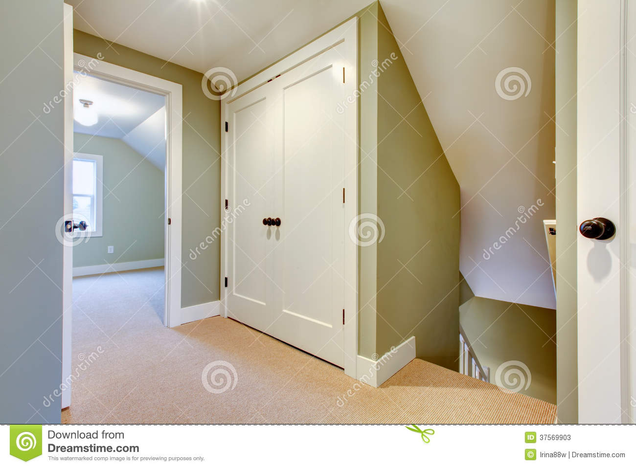 Bright Hallway With Built In Small Storage Room Stock