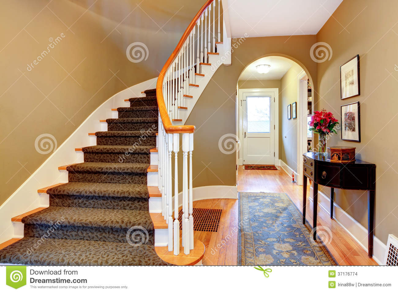 Bright hallway with wood stairs and archway stock photo for Armoire couloir design