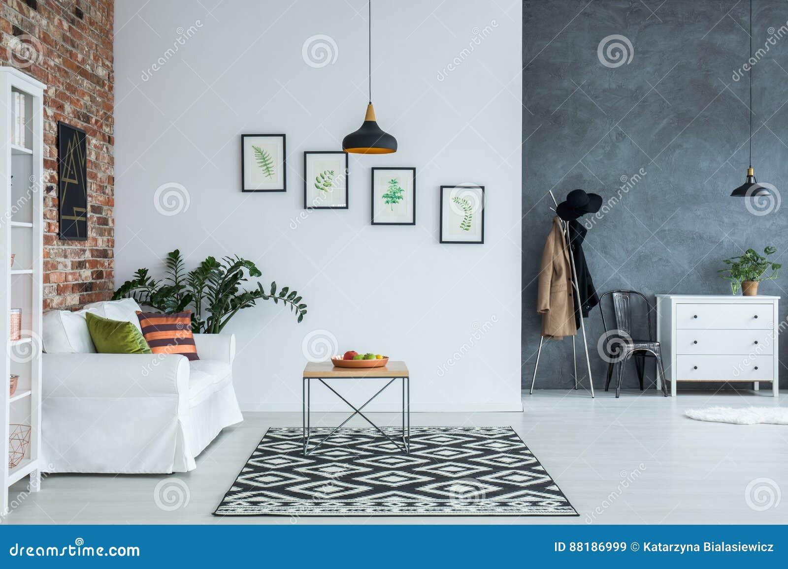Bright home interior with sofa