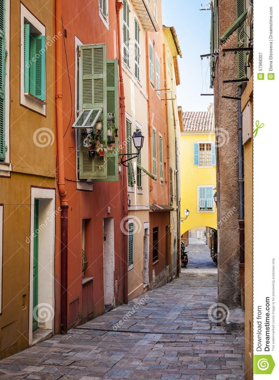 Bright houses on old street in villefranche sur mer stock for Cobblestone shutters