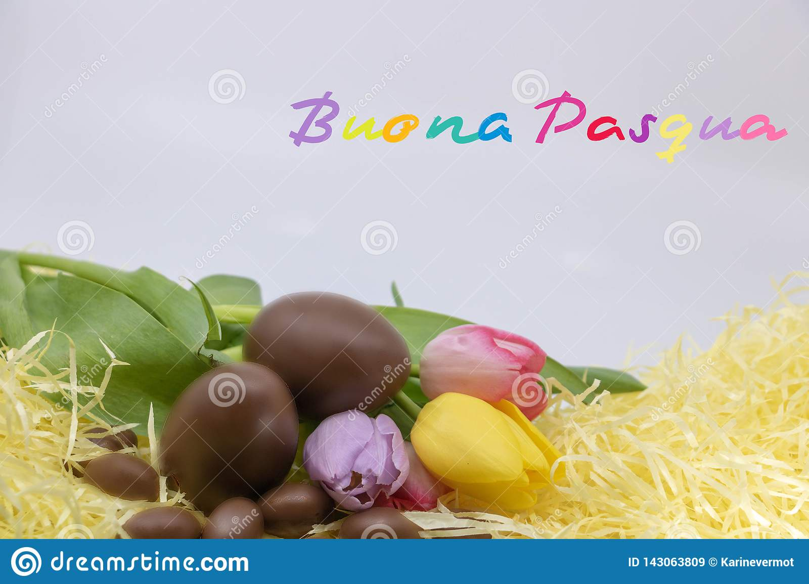 Very colorful text Buona Pasqua is Happy Easter written in  Italian for Easter