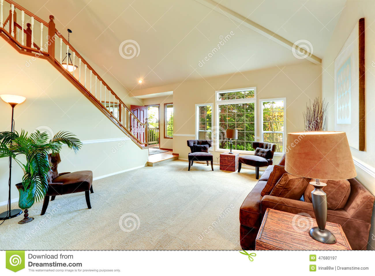 Bright Ivory Living Room With High Vaulted Ceiling And