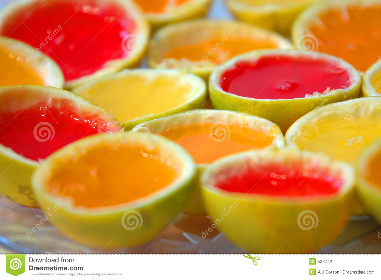 Bright Jelly Childrens Party Food On Orange Rinds Stock Photography