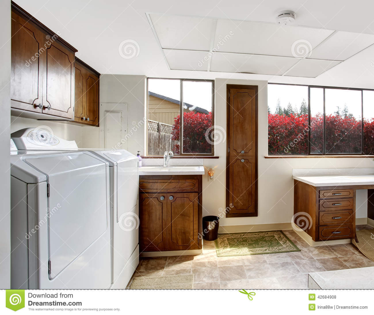 Orange Kitchen Room With White Cabinets Stock Image: Bright Laundry Room With Dark Brown Cabinets Stock Photo
