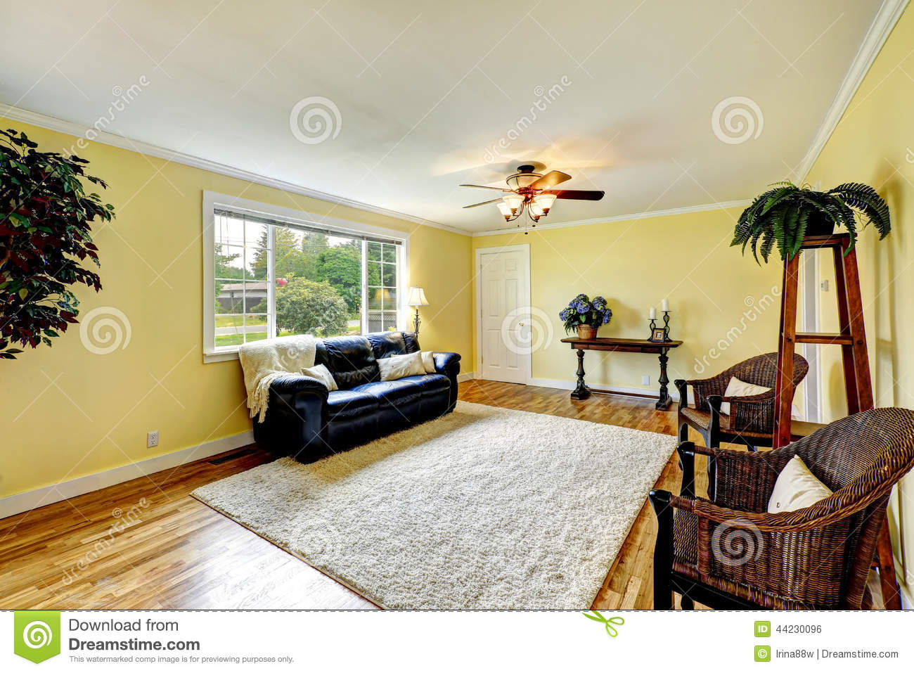 Bright Living Room With Yellow And Red Walls Stock Photo - Image of ...