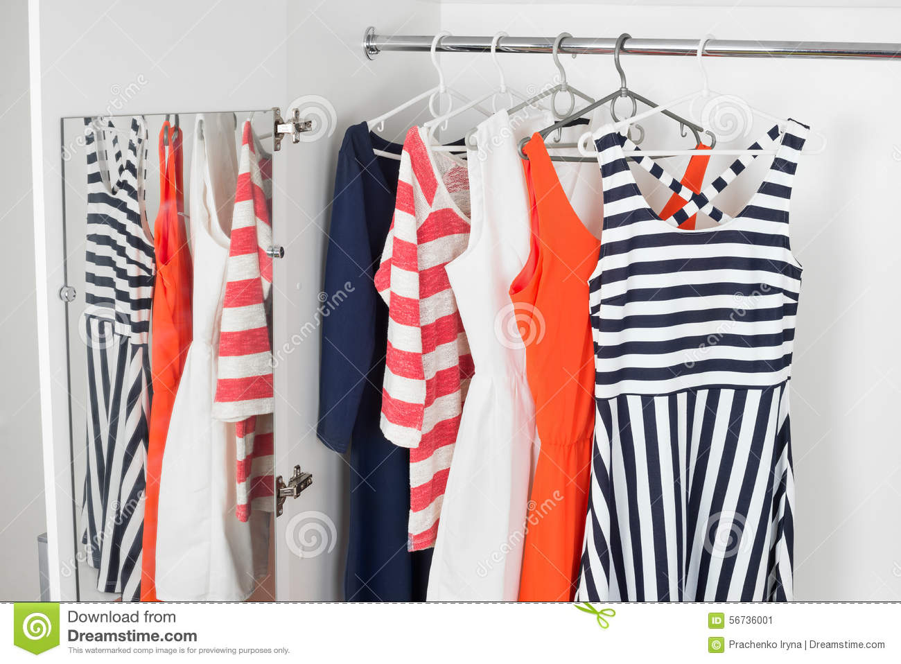 b49eb7bd314 A series of bright modern fashion women s dresses on hangers in a white  cupboard for summer and spring