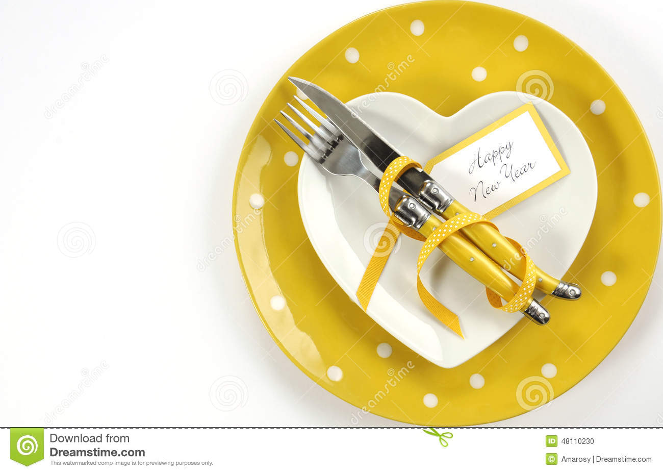 Bright and modern yellow and white theme Happy New Year table