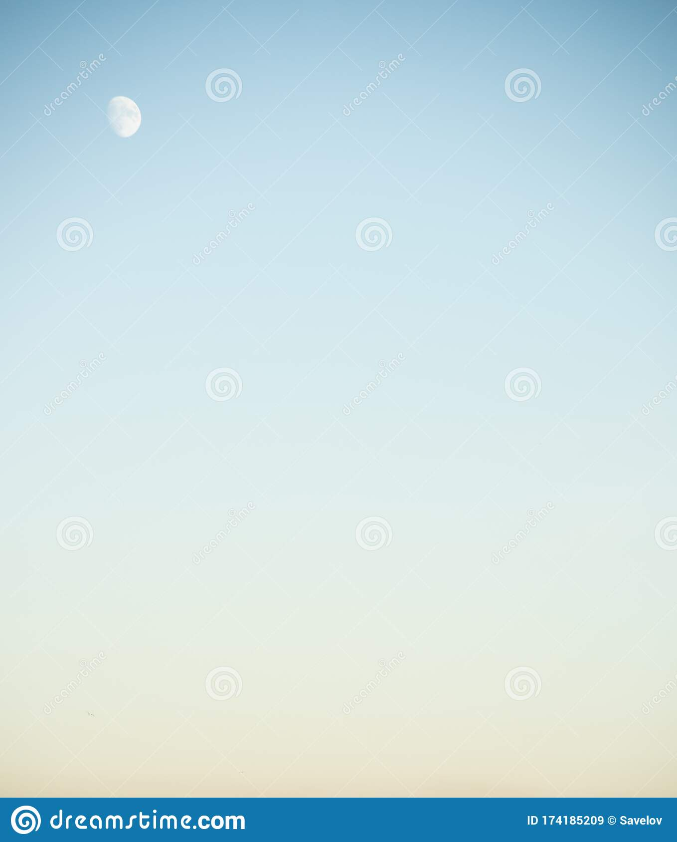 Bright Moon In The Blue And Yellow Sky Stock Image