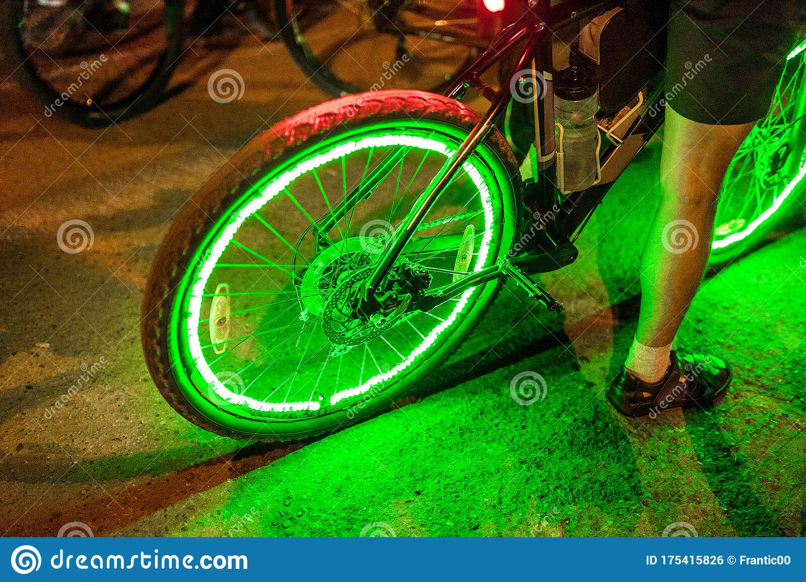 Neon Lights And Illumination On The Wheel Of A Bicycle At Night The Concept Of Safety Of Traffic In The Dark Stock Photo Image Of Design Dark 175415826 Traffic light bicycle night glow neon
