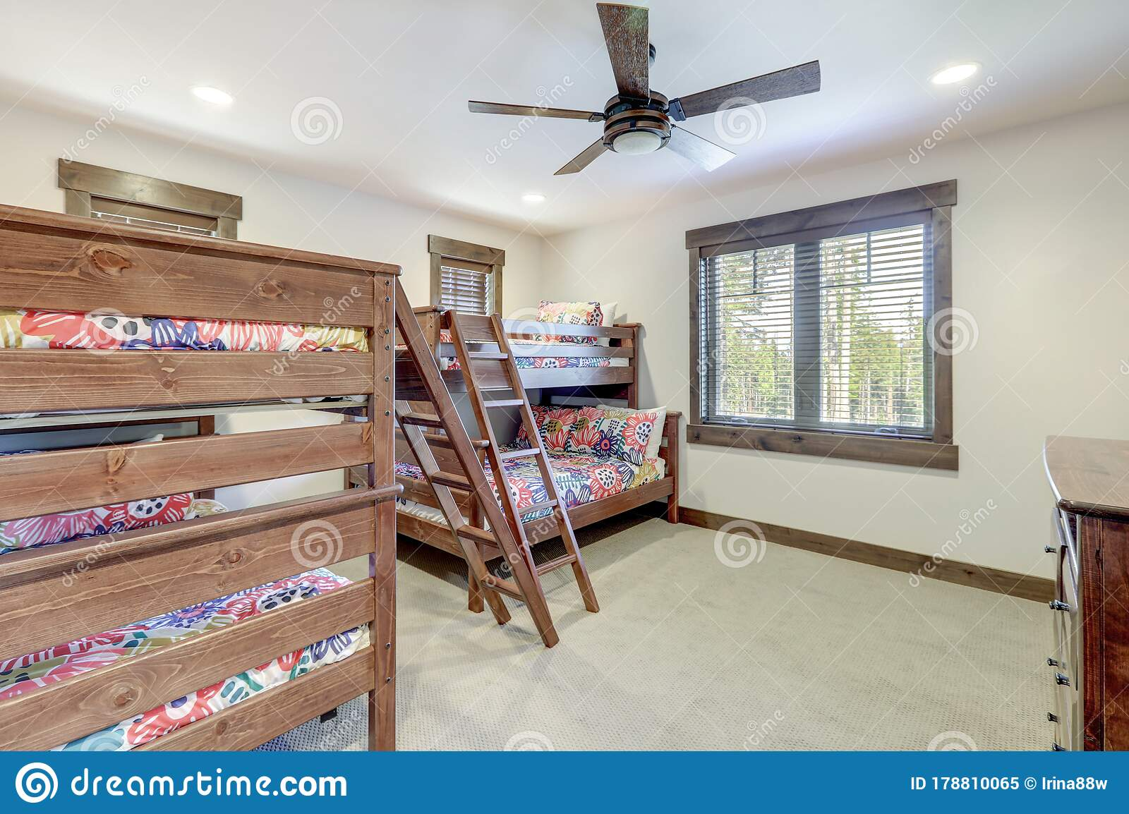Bright New Bedroom With Two Bunk Beds With Colorful Bedding And Ceiling Fan Stock Image Image Of Estate Pillow 178810065
