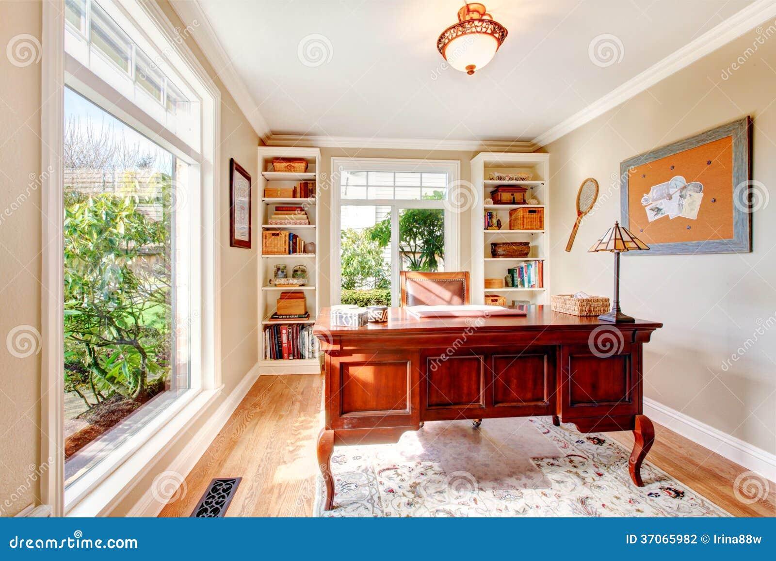 Bright office room with hardwood floor, floor-to-ceiling window, wall