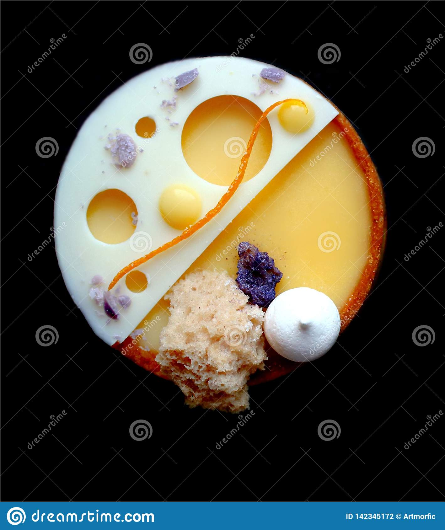 Bright orange tart with meringues, microwave sponge and white chocolate on black background