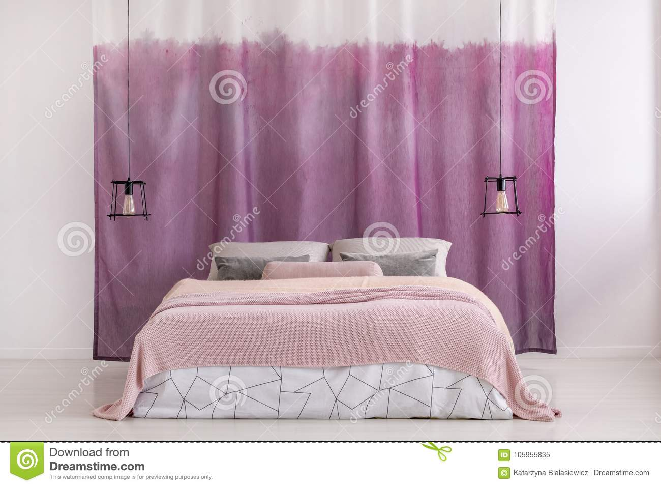 Pink Blanket On King Size Bed Against Violet And White Curtains In Bright  Bedroom With Lamps