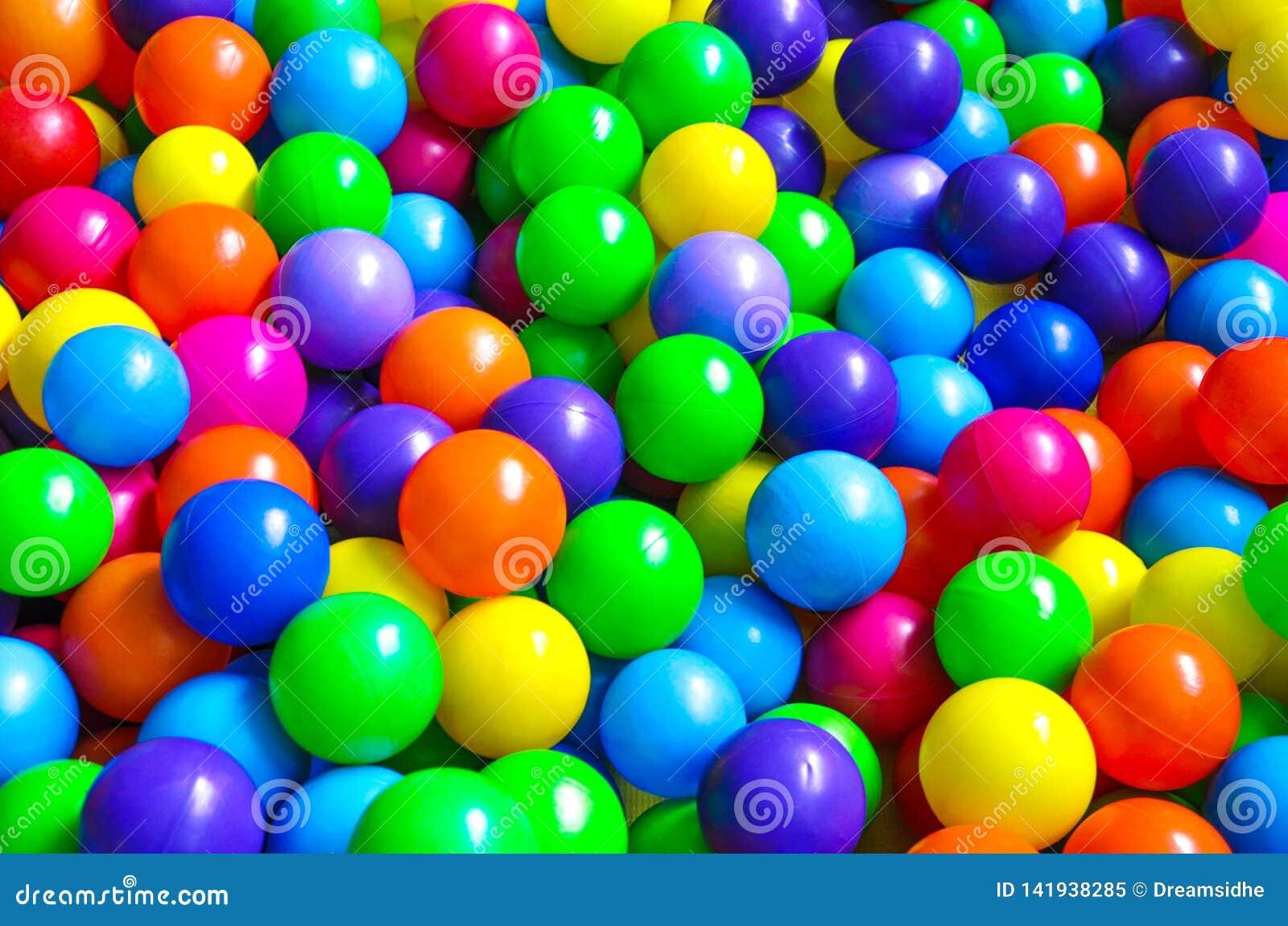 Bright plastic balls on the children`s playground