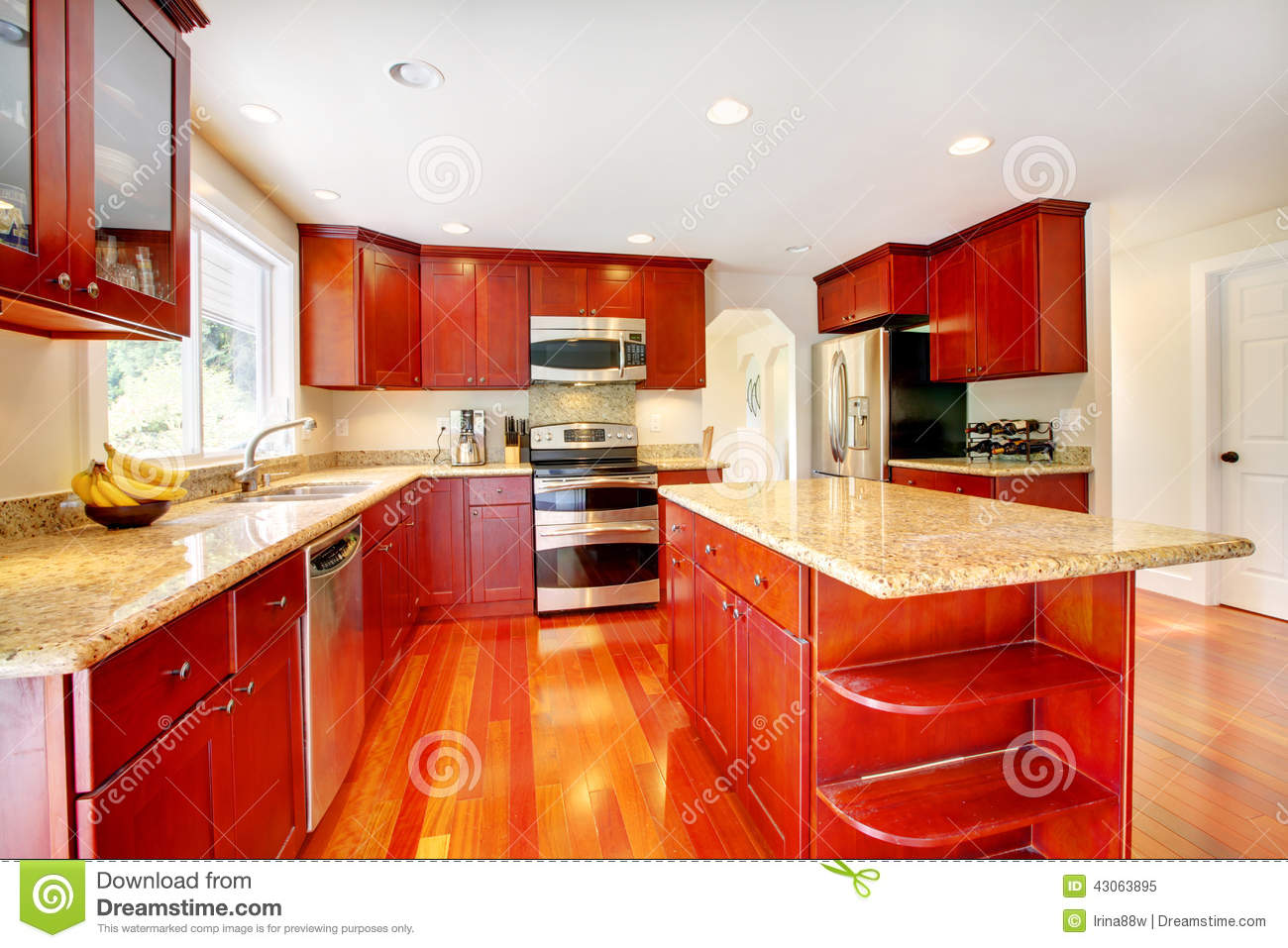 Bright red kitchen room with granite tops and kitchen island