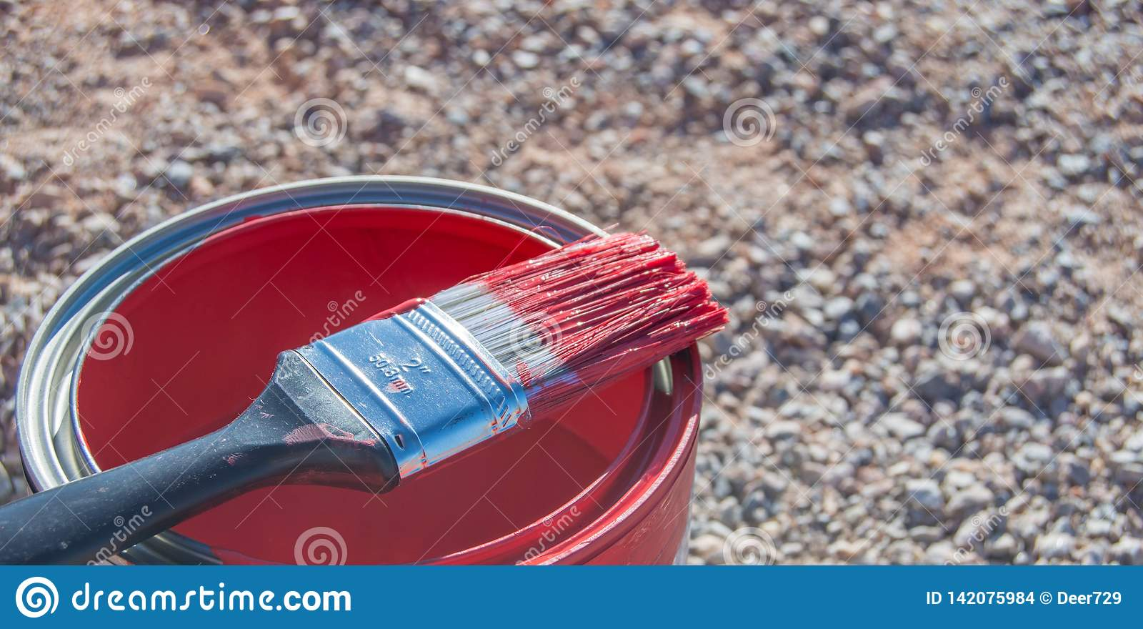 Ckise up on bright red paint in can and brush