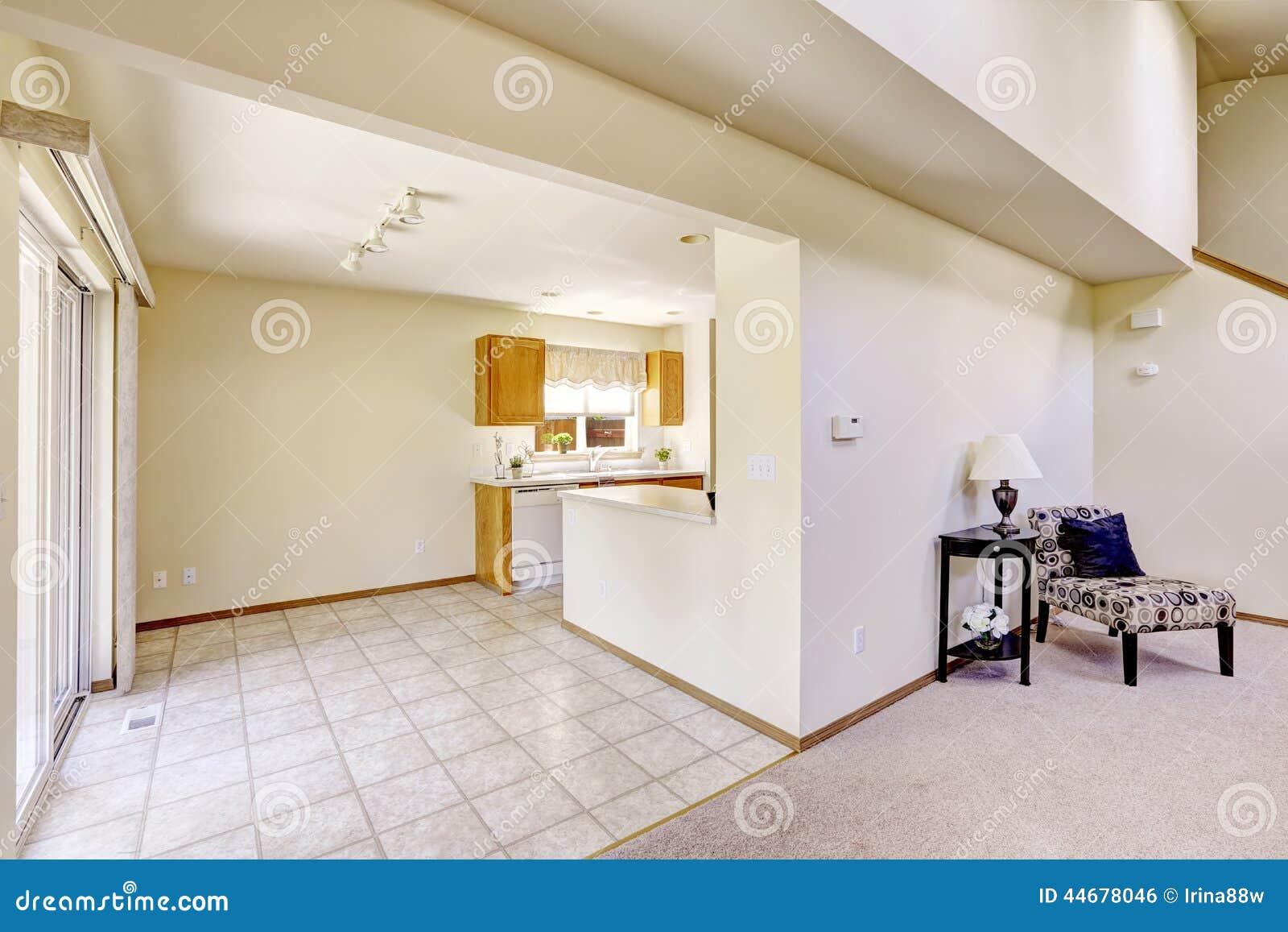 Bright rooms in empty house kitchen area with tile floor for Baldosas interior baratas