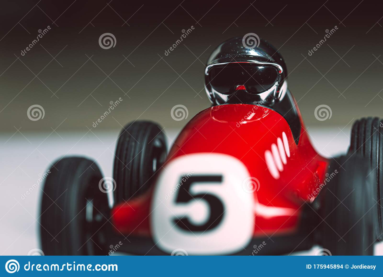 Bright Silver Helmet On A Racing Driver On A Red Toy Vintage Racing Car Stock Photo Image Of Silver Bright 175945894