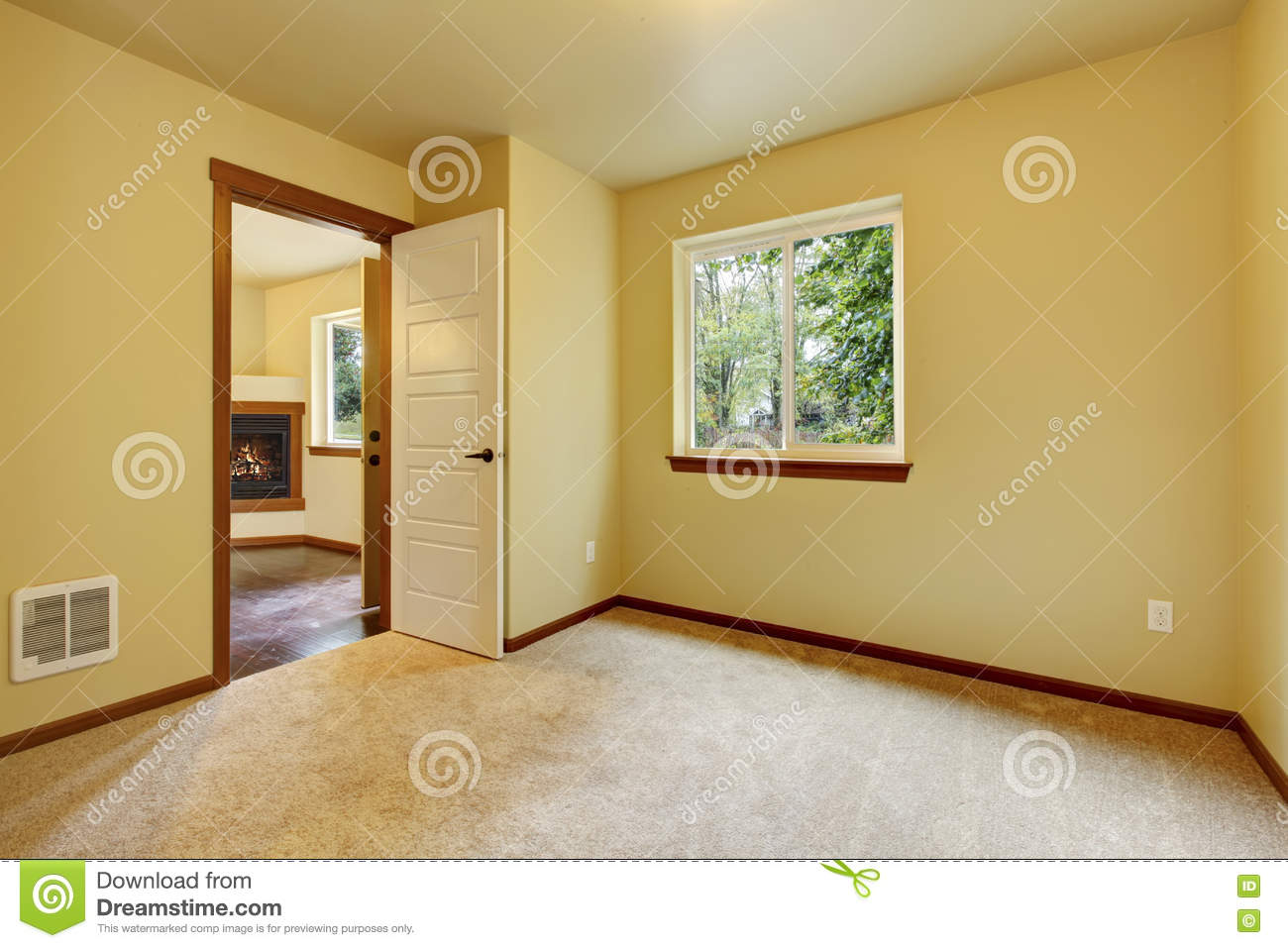Bright Small Empty Room With Carpet Floor And Ivory Walls
