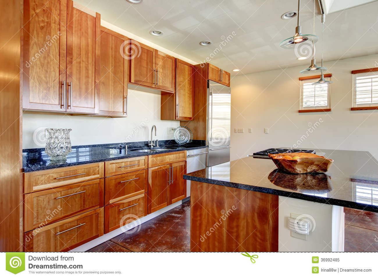 Bright Whiskey Color Kitchen With Black Marble Counter