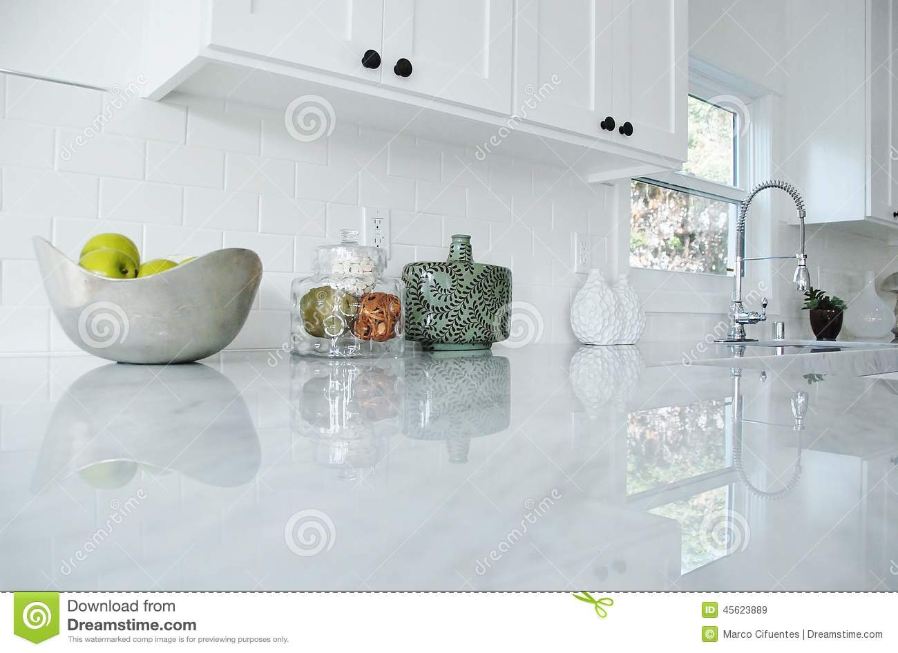 stock photo bright white kitchen carrara marble countertops chrome faucet image white kitchen countertops Kitchen Counter