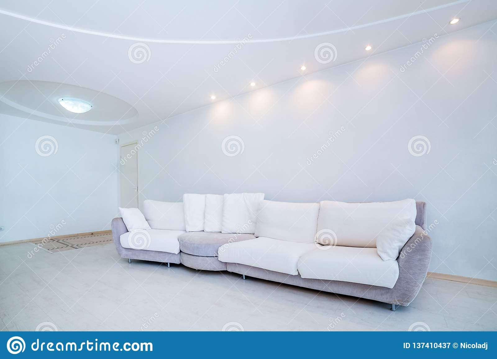 The bright white room with a sofa